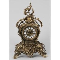 Часы из бронзы с завитком