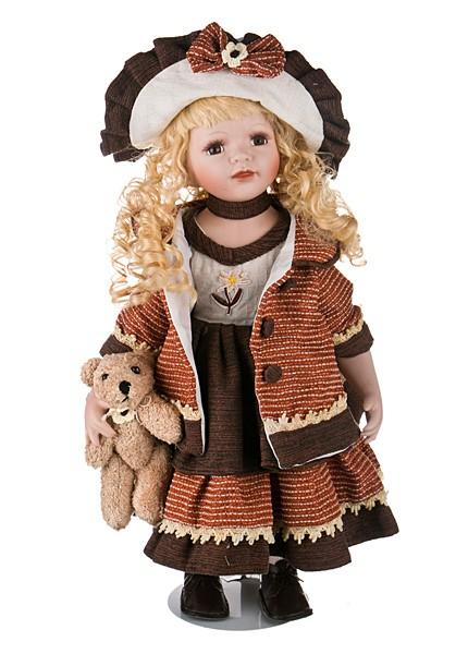 Фарфоровая кукла со светлыми волосами высотой 50 см