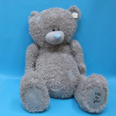 Медведь с заплатками серый