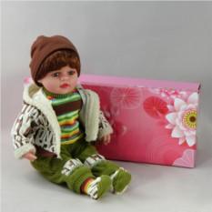 Декоративня виниловая кукла-мальчик в зеленом костюме