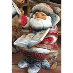 Игрушка из дерева Дед Мороз сидит с книгой