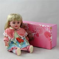 Декоративня виниловая кукла в голубом платье