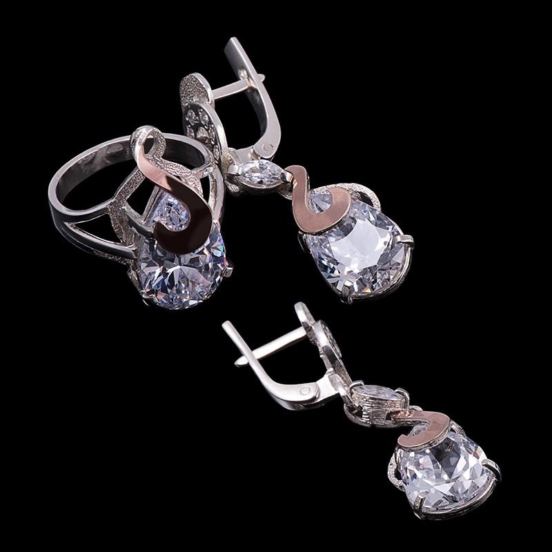 Комплект из серебра и золота с цирконами (серьги.кольцо)