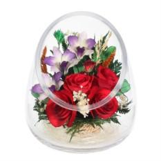 Цветочная композиция из натуральных орхидей и красных роз