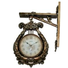 Настенные часы на кронштейне «Лира»