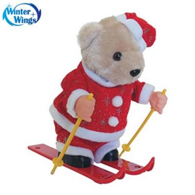 Игрушка Мишка музыкальный, прыгающий на лыжах