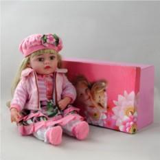 Декоративня виниловая кукла в розовом костюме