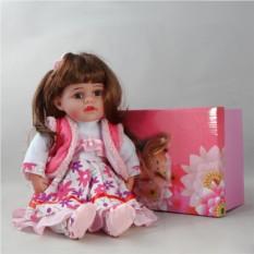 Декоративня виниловая кукла в розовом платье