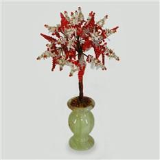 Дерево из красного и белого коралла в вазочке из оникса