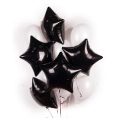 Облако белых шариков с черными звездами