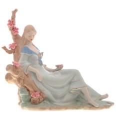 Фарфоровая статуэтка Девушка сидит на цветущем дереве