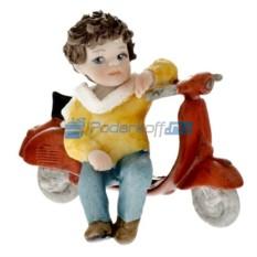 Фарфоровая статуэтка Мальчик сидит на мопеде