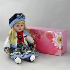 Декоративная виниловая кукла в синем берете