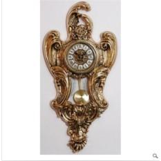 Настенные золотистые часы с маятником