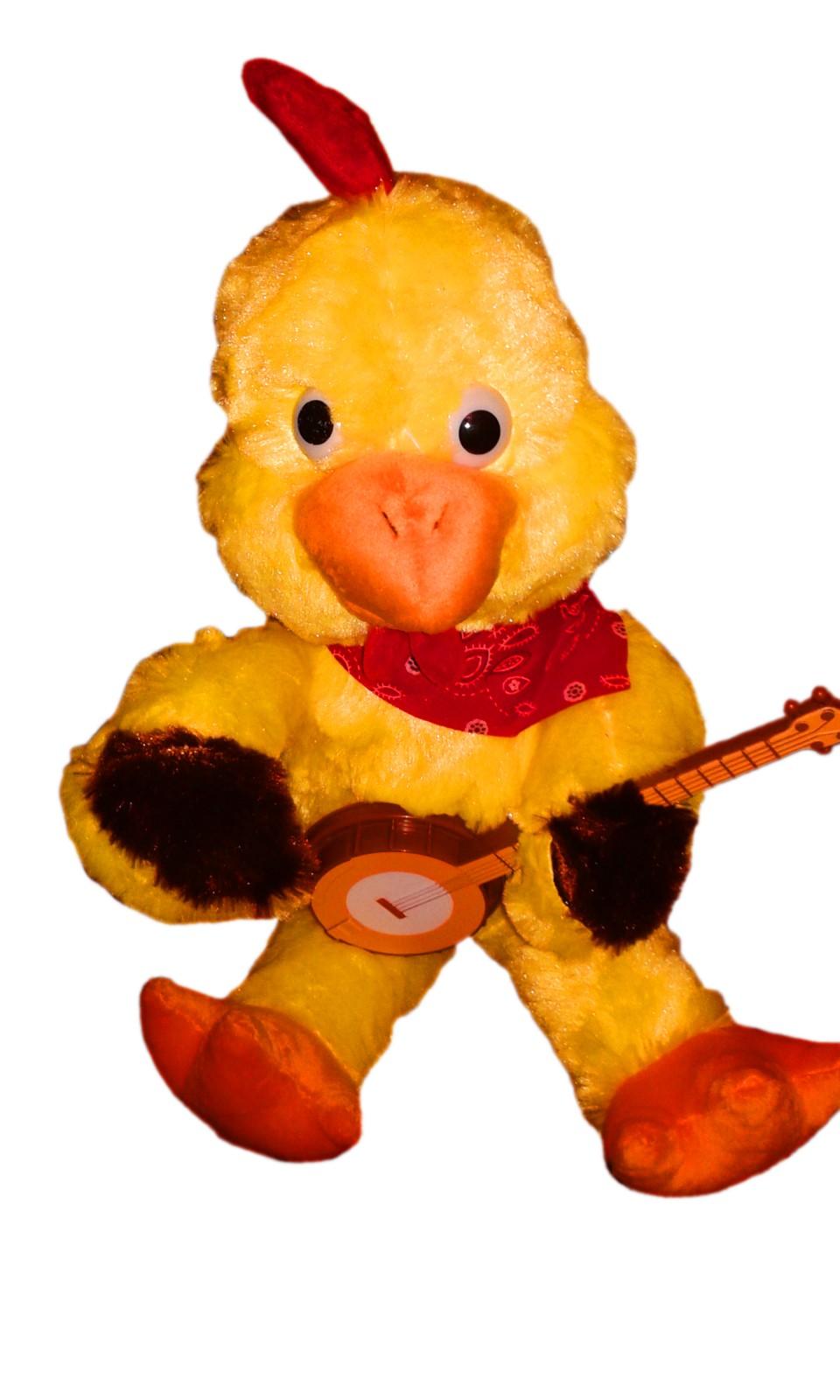 Механическая поющая игрушка Петух с гитарой