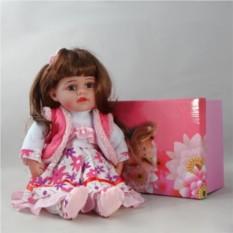 Декоративная виниловая кукла в белом платье в цветочек