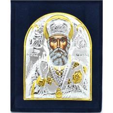 Серебряная икона Николая Чудотворца в бархатном футляре.