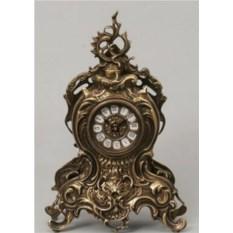 Красивые часы с завитком из бронзы