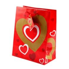 Бумажный ламинированный подарочный пакет с сердечками