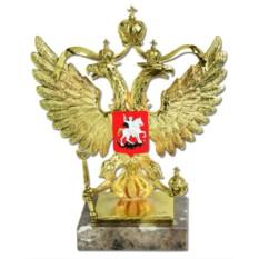 Золотистая скульптура «Герб России»