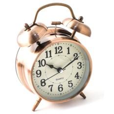 Настольные часы медного цвета