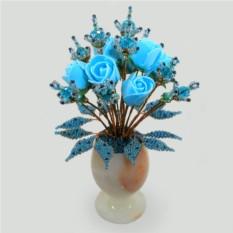 Букет из голубого топаза в вазочке из оникса