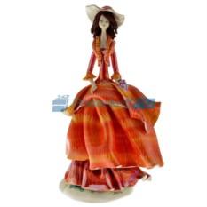 Статуэтка из фарфора Дама в оранжевом платье с виноградом