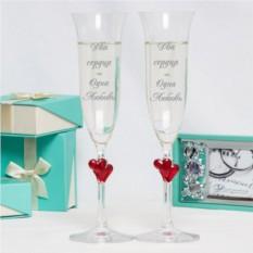 Пара бокалов для шампанского с гравировкой Love is...