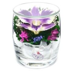 Композиция из натуральных орхидей в стеклянном стакане