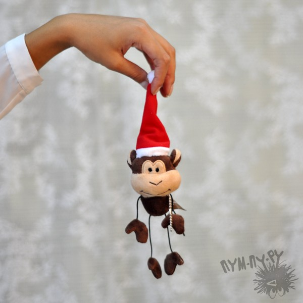Веселая мартышка Санта-Клаус